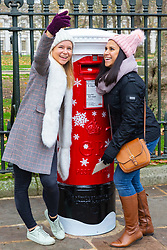 """Today, Royal Mail launches its first ever 'singing' postbox in Greenwich, which plays one of a selection of three Christmas-themed ditties when a letter or card is posted. Four 'singing' festive postboxes in total will be launched across locations in England, Scotland, Wales and Northern Ireland, and will be in place throughout December."""". Greenwich, London, November 23 2018."""