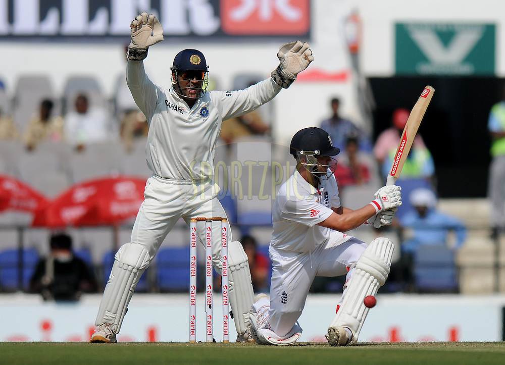 MS Dhoni captain of India appeals unsuccessfully for the wicket of Jonathan Trott of England during day one of the 4th Airtel Test Match between India and England held at VCA ground in Nagpur on the 13th December 2012..Photo by  Pal Pillai/BCCI/SPORTZPICS .