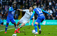 Leeds United's Luke Ayling goes down under the challenge of Wigan Athletic's Gavin Massey<br /> <br /> Photographer Alex Dodd/CameraSport<br /> <br /> The EFL Sky Bet Championship - Leeds United v Wigan Athletic - Saturday 1st February 2020 - Elland Road - Leeds<br /> <br /> World Copyright © 2020 CameraSport. All rights reserved. 43 Linden Ave. Countesthorpe. Leicester. England. LE8 5PG - Tel: +44 (0) 116 277 4147 - admin@camerasport.com - www.camerasport.com