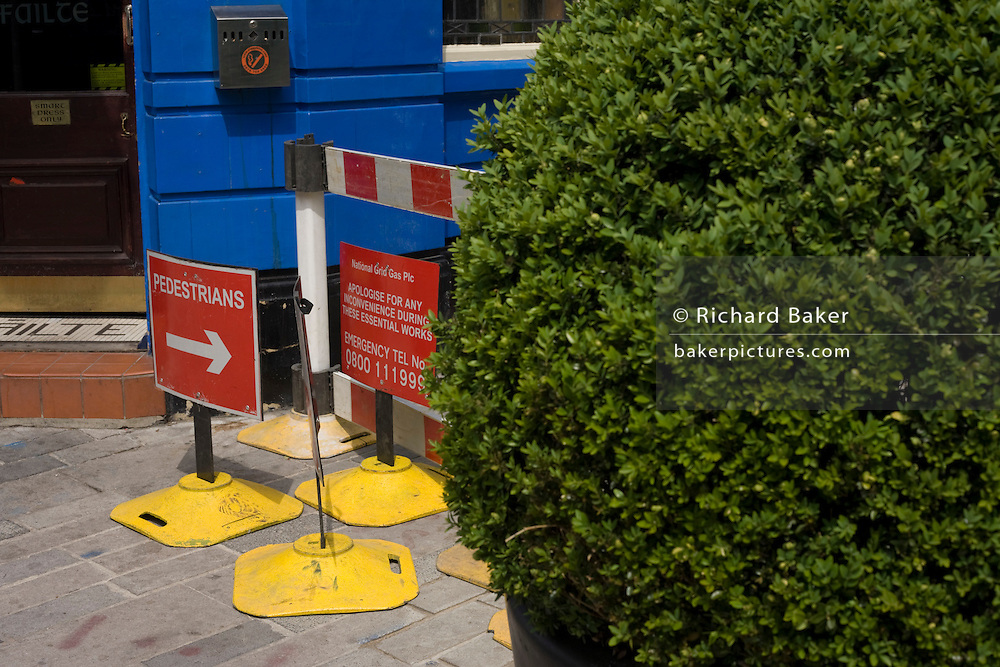 Pavement repairs and pedestrian signs in the City of London