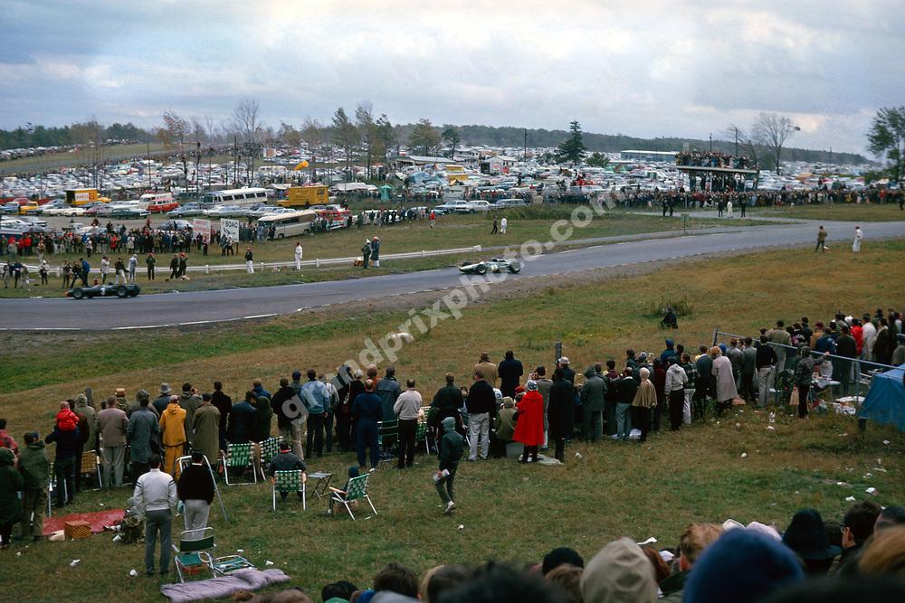 Graham Hill (BRM) leads Jim Clark (Lotus-Climax) in the 1965 United States Grand Prix in Watkins Glen. Photo: Grand Prix Photo