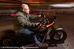 Riding Main Street at night during Daytona Beach Bike Week, FL. USA. Sunday, March 10, 2019. Photography ©2019 Michael Lichter.