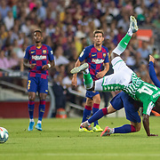BARCELONA, SPAIN - August 25:  William Carvalho #14 of Real Betis collides with Antoine Griezmann #17 of Barcelona during the Barcelona V  Real Betis, La Liga regular season match at  Estadio Camp Nou on August 25th 2019 in Barcelona, Spain. (Photo by Tim Clayton/Corbis via Getty Images)