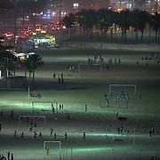 Locals play football at night under floodlight on Copacabana Beach, Rio de Janeiro, Brazil. 21st July 2010. Photo Tim Clayton.