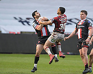Rhys Williams (22) of Salford Red Devils takes a clean catch while under pressure from Umyla Hanley (30) of Wigan Warriors