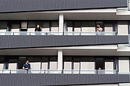 Several people watch on from their balconies as the demonstrators march through the street during the Freedom protest on October 23, 2020 in Melbourne, Australia. Freedom protests are being held in Melbourne in response to the governments COVID-19 restrictions and continuing removal of liberties despite new cases being on the decline. Victoria recorded a further 1 new cases overnight along with no deaths recorded.(Photo by Mikko Robles/Speed Media)