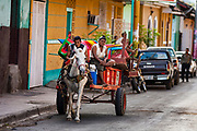 09 JANUARY 2007 - GRANADA, NICARAGUA:  A horse drawn cart used to deliver plastic furniture in Granada, Nicaragua. Granada, founded in 1524, is one of the oldest cities in the Americas. Granada was relatively untouched by either the Nicaraguan revolution or the Contra War, so its colonial architecture survived relatively unscathed. It has emerged as the heart of Nicaragua's tourism revival.  Photo by Jack Kurtz