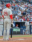 ATLANTA - JUNE 30:  Second baseman Chase Utley #26 of the Philadelphia Phillies looks down to the first base coach during the game against the Atlanta Braves at Turner Field on June 30, 2009 in Atlanta, Georgia.  The Braves beat the Phillies 5-4 in 10 innings.  (Photo by Mike Zarrilli/Getty Images)