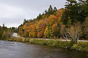 Highway 110 in Stark in Fall by river.