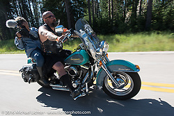 Tom Wolf of Sweden (wearing a kilt) rides Rebecca Cunningham as she films the Harley-Davidson Angels Ride to benefit the Nature Conservancy during the annual Sturgis Black Hills Motorcycle Rally.  SD, USA.  August 12, 2016.  Photography ©2016 Michael Lichter.
