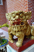 Temple Dog with mouth full of burnt incense sticks. Cao Dai Temple, Vung Tau, Vietnam