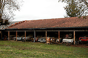 Now where did I park my 60 cars? Incredible treasure trove of rusting classics worth £12MILLION is found languishing in a French farm garage after 50 years<br /> <br /> A 12million euros treasure trove of 60 rusting classic cars left languishing on a French farm for 50 years has gone up for auction.The haul of motors, which includes dozens of vintage sports cars, was found gathering dustunder piles of newspapers in garages and barns on a farm in western France.Among the vehicles up for sale are a Ferrari once sat in by Jane Fonda and a Talbot-Lago previously owned by extravagant Egyptian King Farouk<br /> <br /> <br /> The cars were collected from the 1950s to the 1970s by entrepreneur Roger Baillon, who dreamt of restoring them to their former glory and displaying them in a museum.<br /> However, his plans were dashed as his business struggled, forcing Mr Baillon to sell about 50 of the vehicles.<br /> Since then his collection has sat dormant in makeshift corrugated iron shelters and outbuildings on the farm.<br /> Mr Baillon died about 10 years ago and his son, Jacques, who inherited the collection, died last year.<br /> Mr Baillon's grandchildren had no idea of the extent of the collection, calling in car specialists Matthieu Lamoure and Pierre Novikoff of auctioneers Artcurial Motorcars to estimate its value.<br /> <br /> They found a 1956 Maserati A6G Gran Sports with coachwork by prominent designer Frua, one of just three in the world, which is estimated to sell for just under £1million.<br /> But the auctioneers' greatest discovery was that of a 1961 Ferrari 250GT SWB California Spider with covered headlights, which was hidden beneath piles of newspapers.<br /> The car was previously owned by French actors Gerard Blain and Alain Delon, who was photographed in it with Jane Fonda and Shirley MacLaine, and is expected to attract attention from Ferrari collectors with an estimate of £9.5million.<br /> Only 36 of the particular model of Ferrari were ever made, in