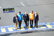 April 21, 2014 - Boston, Massachusetts, U.S. - <br /> <br /> Boston Marathon 2014<br /> <br />  Current Boston Mayor Marty Walsh, second from left, joins former Boston Mayor Thomas Menino, center, and Marathon icon Bill Rodgers to walk across the finish line of the 2014 Boston Marathon in Boston, Massachusetts. <br /> ©Exclusivepix