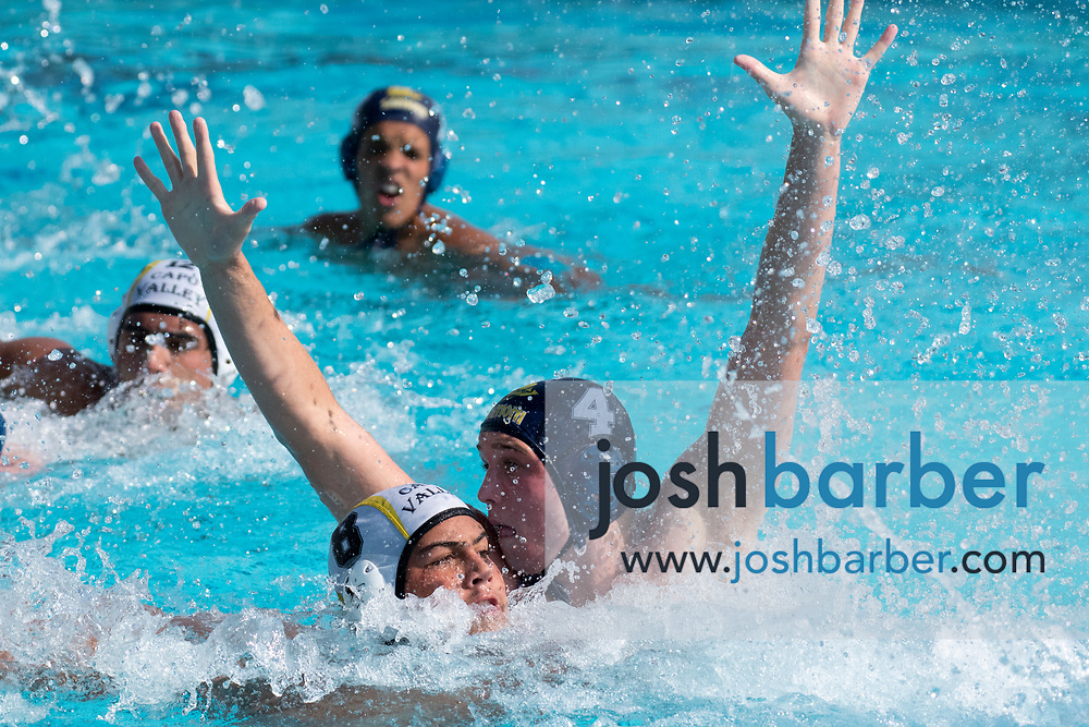 Capistrano Valley's Ethan Pranajaya, Santa Monica's Sawyer Koetters during the CIF-SS Division 4 boys water polo Final at William Woollett Jr. Aquatic Center on Saturday, November 10, 2018 in Irvine, Calif. (Photo by Josh Barber, Contributing Photographer)