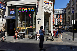 © Licensed to London News Pictures. 29/06/2018. LONDON, UK.  A Costa coffee shop joins other stores in the Oxford Street area receiving a rainbow makeover in support of the Pride Festival, a worldwide celebration of the LGBT community.  The popular annual Pride London parade takes place in the capital on 7 July.  Photo credit: Stephen Chung/LNP