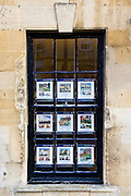 Property details in estate agents window, Chipping Campden, Gloucestershire, UK