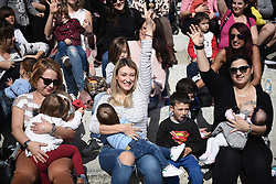 November 4, 2018 - Thessaloniki, Greece - Women raise their hands as they breast feed their babies during the 9th Annual Public Breastfeeding event. Hundreds of mothers breast fed their babies in the 9th public breastfeeding event, at the northern Greek city of Thessaloniki, in order to draw attention to the health benefits of breastfeeding for mothers and children as well, and to encourage public breastfeeding. (Credit Image: © Giannis Papanikos/ZUMA Wire)