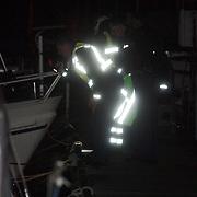 NLD/Huizen/20080203 - Persoon te water bij zijn boot, zoekactie politie en brandweer