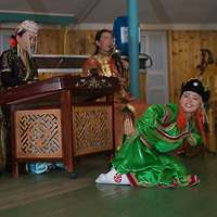 A Mongolian dancer performs at a tourist ger camp by Lake Hovsgol in Lake Hovsgol National Park.