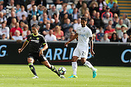 Eden Hazard of Chelsea (l) is challenged by Kyle Naughton of Swansea city.  Premier league match, Swansea city v Chelsea at the Liberty Stadium in Swansea, South Wales on Sunday 11th Sept 2016.<br /> pic by  Andrew Orchard, Andrew Orchard sports photography.