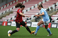 Manchester City forward Georgia Stanway (10) and Manchester United defender Ona Batlle (17) during the FA Women's Super League match between Manchester United Women and Manchester City Women at Leigh Sports Village, Leigh, United Kingdom on 14 November 2020.
