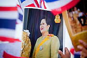 """Apr. 18, 2010 - Bangkok, Thailand: A Thai monarchist holds up a picture of the Queen Sirikit, the Queen of Thailand. Thousands of so called """"Pink Shirts"""" jammed the area around Victory Monument in Bangkok to show support the Thai Monarch, King Bhumibol Adulyadej, and against the Red Shirts, who are demonstrating just a few kilometres away in the Ratchaprasong area. The Pink Shirts claim to not support either of the other political factions who wear colors - the Red Shirts, who support deposed Prime Minister Thaksin Shinawatra and their opponents the Yellow Shirts, who are against Thaksin.    Photo By Jack Kurtz"""
