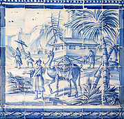 Blue and white azulejo tiles Oriental Far Eastern landscape China with camel, University of Evora, Portugal