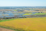 Aerial photograph of flooded rural farmland in Mills County, Iowa, USA, with the Missouri River in the background.