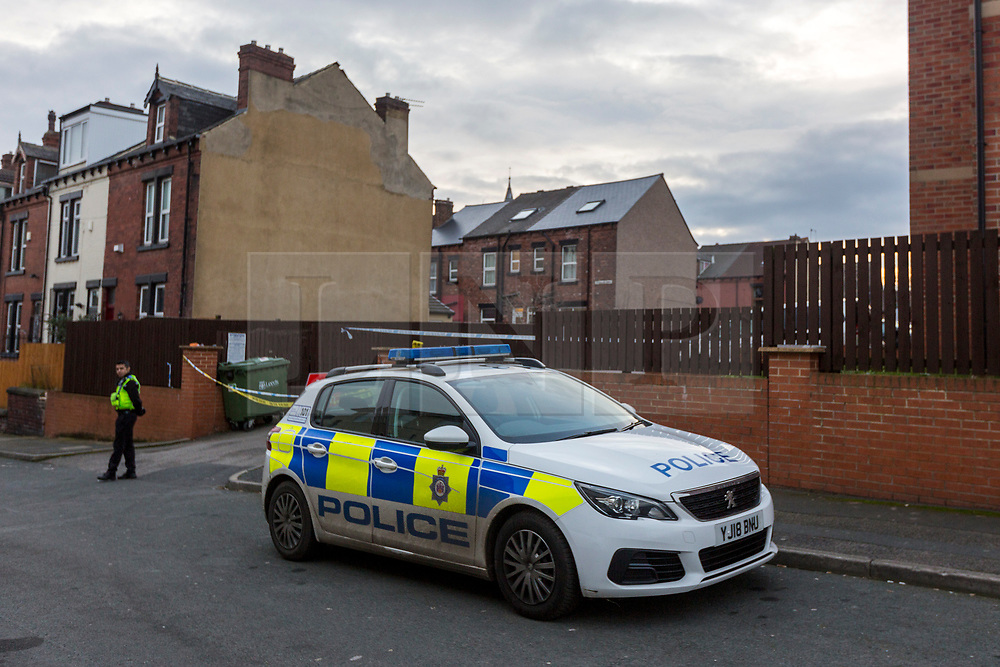 © Licensed to London News Pictures. 13/02/2019. Leeds UK. Police remain at the scene on Athlone Grove in Leeds this morning after the body of a woman was found inside a block of flats. A man has been arrested on suspicion of murder after he fell from a bridge over the A64 in Leeds. Photo credit: Andrew McCaren/LNP