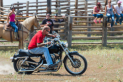 Mike Halachik barrel racing Hilary Goloda's Sportster in the Spur Creek Ranch rodeo arena on highway 79 north of Sturgis on the Michael Lichter - Sugar Bear ride during the annual Sturgis Black Hills Motorcycle Rally. SD, USA. August 3, 2014.  Photography ©2014 Michael Lichter.