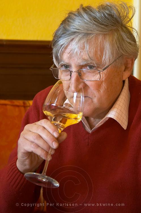 Bernard Jany Chateau la Condamine Bertrand. Pezenas region. Languedoc. Owner winemaker. Tasting wine. France. Europe. Wine glass.