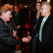 NLD/Rotterdam/20130209 - De Franse modeontwerper Jean Paul Gaultier opent zijn tentoonstelling in de Kunsthal Rotterdam, Jean Paul Gaultier en directeur Emily Ansenk in gesprek met fotograaf Vincent Mentzel