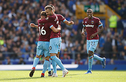West Ham United's Andriy Yarmolenko (second right) celebrates scoring his side's second goal of the game with team-mates Mark Noble (left) and Fabian Balbuena (behind)