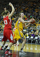 January 08 2010: Iowa center Morgan Johnson (12) eyes the basket as Ohio St. forward Sarah Schulze (43) defends during the first half of an NCAA womens college basketball game at Carver-Hawkeye Arena in Iowa City, Iowa on January 08, 2010. Iowa defeated Ohio State 89-76.