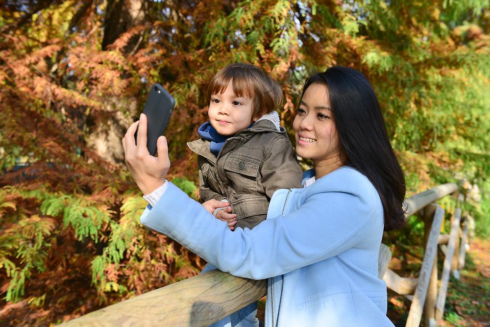 Portrait of a Thai mum wiht her toddler in a public park
