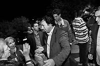 Torretta, Italy, 17 October 2012: Nino Dina (center), a candidate for the Sicilian Regional Assembly, is about to hug his supporters after a speech in a restaurant during a sausage and pizza night organized by his supporters in Torretta, Italy, on 17 October 2012. Nino Dina, a 55 years representative of the Sicilian Regional Assembly (ARS) running for the fourth time since 2001, was under investigation for Mafia ties in 2008. The case was archived in 2010.<br /> <br /> <br /> The direct elections in Sicily for the President of the Region and its representatives will take place on Sunday 28 October 2012, 6 months ahead of the end of the terms of office of the current legislature. The anticipated election of October 28 take place after Raffaele Lombardo, former governor of Sicily since 2008, resigned on July 31st. Raffaele Lombardo is under investigation since 2010 for Mafia ties. His son Toti Lombardo is currently running for a seat in the Sicilian Regional Assembly in the coalition of Gianfranco Micciché, a candidate for the Presidency of the Region. 32 candidates belonging to 8 of the 20 parties running for the Sicilian elections are either under investigation or condemned. ### Torretta, Italia, 17 ottobre 2012: Nino Dina (al centro), un candidato per l'Assemblea Regional Siciliana con l'UdC (Unione di Centro), abbraccia le sue sostenitrici dopo un comizio in un ristorante durante una mangiata di salsiccia e pizza organizzata dai suoi sostenitori a Torretta, Italia, il 17 ottobre 2012.  Nino Dina, un deputato di 55 anni dell'Assemblea Regionale Siciliana (ARS) candidato per la quarta volta dal 2001, è stato indagato per concorso esterno in associazione mafiosa nel 2008. Il suo fascicolo è stato archiviato nel 2010.<br /> <br /> Le elezioni in Sicilia per la votazione diretta del presidente della regionee dei deputati all'Assemblea regionale (ARS)si terranno domenica 28 ottobre, in anticipo sulla scadenza naturale dell'attuale legislatura, prevista ad aprile dell'an
