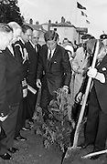 President John F. Kennedy attends a Garden Party at Aras an Uachtarain.  Kennedy plants a Californian Redwood in the grounds of the residence, watched by President de Valera and Mr. Frank Aiken, Minister for External Affairs (left)..27.06.1963. JFK visit to Ireland in 1963. photos john f kennedy, photos of john f kennedy,<br />