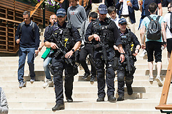 © Licensed to London News Pictures. 01/07/2019. London, UK. Armed police patrol the grounds on the first day of the Wimbledon Tennis Championships 2019 held at the All England Lawn Tennis and Croquet Club. Photo credit: Ray Tang/LNP