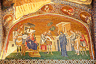 The 11th century Roman Byzantine Church of the Holy Saviour in Chora and its mosaic of Joseph and Mary and the enrollment for the census for taxation (panel A-2). Endowed between 1315-1321  by the powerful Byzantine statesman and humanist Theodore Metochites. Kariye Museum, Istanbul .<br /> <br /> If you prefer to buy from our ALAMY PHOTO LIBRARY  Collection visit : https://www.alamy.com/portfolio/paul-williams-funkystock/holy-saviour-chora-istanbul.html<br /> <br /> Visit our TURKEY PHOTO COLLECTIONS for more photos to download or buy as wall art prints https://funkystock.photoshelter.com/gallery-collection/3f-Pictures-of-Turkey-Turkey-Photos-Images-Fotos/C0000U.hJWkZxAbg