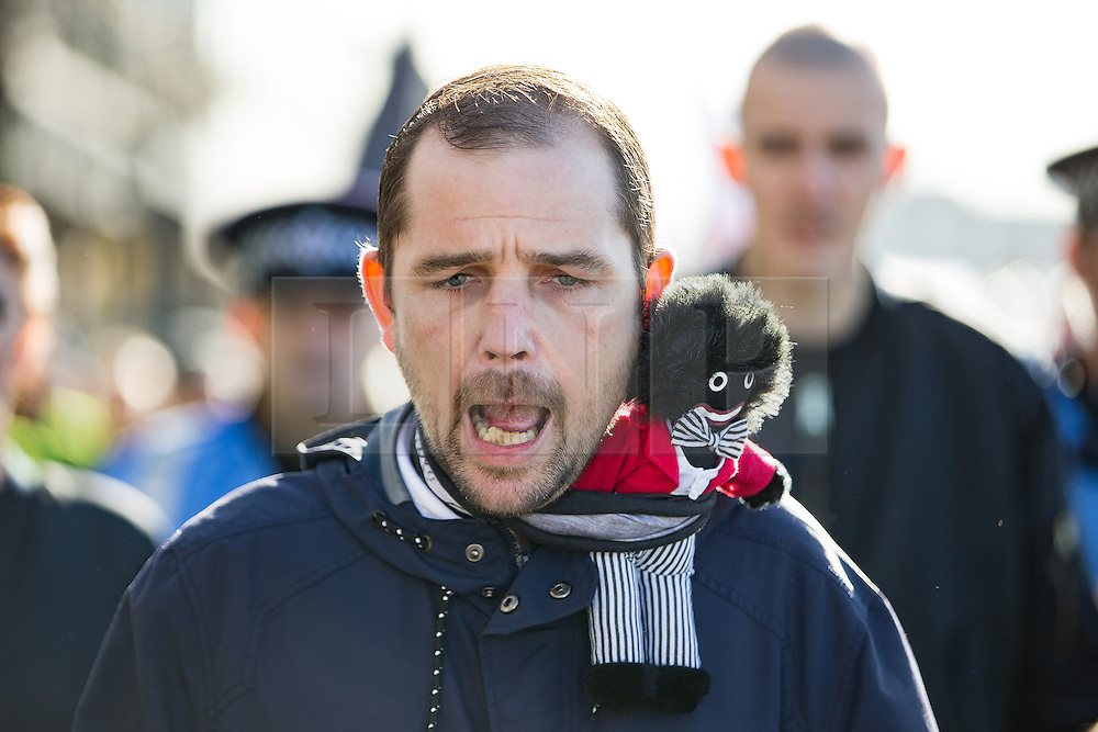 © Licensed to London News Pictures . 22/10/2016 . Margate , UK . A White Lives Matter protester with a Golliwog on his shoulder . A White Lives Matter protest and march , opposed by antifascists , is held in Margate , Kent . Photo credit : Joel Goodman/LNP