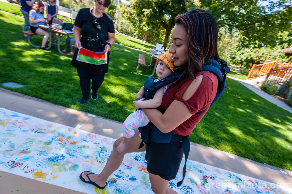 """Wingtip Press, the City of Boise and Idaho Conservation League's  Print Boise River event at The Cabin, Boise, Idaho on July 13, 2019.<br />  <br /> Wingtip Press, the City of Boise ,and Idaho Conservation League partnered up to celebrate our love for the Boise River.<br /> <br /> This collaborative effort was directed by artist Amy Nack, founder of Wingtip Press and sponsored through a grant from Boise City Arts & History Department.<br /> <br /> PRINT BOISE RIVER participants carved fish, water images, birds and trees, adhered them to the bottom of flip flops and """"walked"""" their image along a 150' feet of paper. Each participant will become a public artist when the mural is displayed during Boise's First Thursday event in August 2019<br /> <br /> Lana Weber, ICL's Community Engagement Coordinator joined art makers to talk about the rivers contribution to our way of life in Boise."""