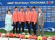 JAAF President Hiroshi Yokokawa (right) and Yokohama mayor Fumiko Hayashi (left) pose with members of the Japan 4 x 100m relay, Yoshihide Kiryu,Yuki Koike, Ryota Yamagata and Shuhei Tada, during a news conference prior to the IAAF World Relays, Friday, May 10, 2019,  in Yokohama, Japan.
