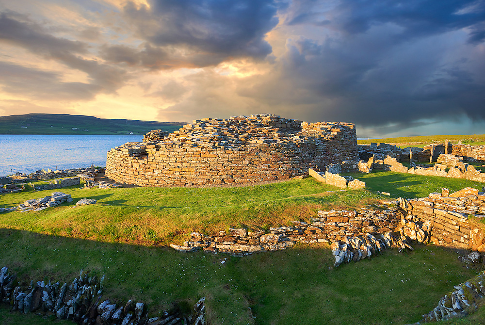 The Broch of Gurness is a rare example of a well preserved iron age Broch village. Dating from 500 to 200BC the central round tower probably reached 10 meters (30ft). This was surrounded by thatched roofed houses. The settlement was surrounded by walls and two deep ditches. Gurness was probably the most important settlement on Orkney 2000 years ago.