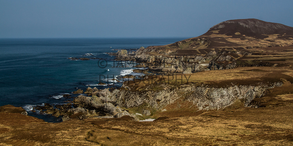 A view along Islay's North Coast. The hill of Mhala Bholsa is visible on the right