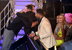 Dan Osborne embraces Ben Jardine after he leaves the house after finishing in third place during the live final of Celebrity Big Brother at Elstree Studios, Hertfordshire.