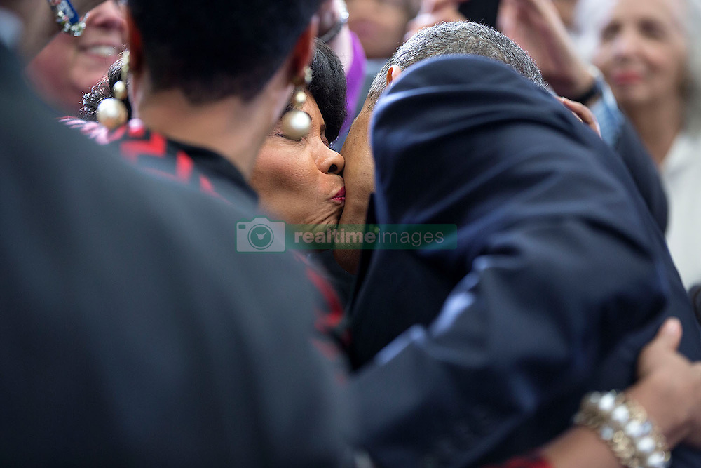 President Barack Obama receives a kiss from an  audience member following remarks on the economy at Lawson State Community College in Birmingham, Ala., March 26, 2015. (Official White House Photo by Pete Souza)<br /> <br /> This official White House photograph is being made available only for publication by news organizations and/or for personal use printing by the subject(s) of the photograph. The photograph may not be manipulated in any way and may not be used in commercial or political materials, advertisements, emails, products, promotions that in any way suggests approval or endorsement of the President, the First Family, or the White House.