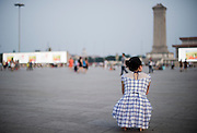 "A Chinese girl sits in Tiananmen square in Beijing, China, July 19, 2014.<br />   <br /> This picture is part of the series ""Urban Chinese Streets"", a journey on the streets of Chinese cities to discover their modern citizens and habits.      <br /> <br /> © Giorgio Perottino"
