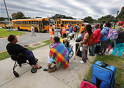Hundreds of local residents being evacuated from the city at the Savannah Civic Center wait to board buses during a mandatory evacuation for Hurricane Irma on Saturday, September 9, 2017, in Savannah, Ga. Officials are expecting 1,500 to 3,000 without transportation to leave by buses that are being provided. Photo by Curtis Compton/Atlanta Journal-Constitution/TNS/ABACAPRESS.COM