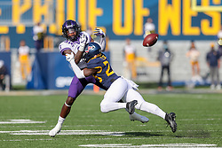 Nov 14, 2020; Morgantown, West Virginia, USA; West Virginia Mountaineers safety Tykee Smith (23) breaks up a pass intended for TCU Horned Frogs running back Zach Evans (6) during the first quarter at Mountaineer Field at Milan Puskar Stadium. Mandatory Credit: Ben Queen-USA TODAY Sports