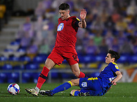 Football - 2020 / 2021 Sky Bet League One - AFC Wimbledon vs Wigan Athletic - Plough Lane<br /> <br /> Wigan Athletic's Jamie Proctor is tackled by AFC Wimbledon's George Dobson.<br /> <br /> COLORSPORT/ASHLEY WESTERN
